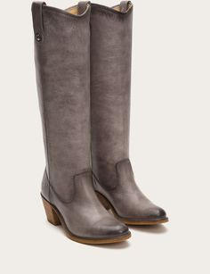 A stunning display of classic style, this knee-high boot steps right off the polo field into the party. Washed antique pull up leather is hand burnished to perfection and embellished with our signature buttons at the pull tabs. Truly a boot that becomes more beautiful with age. Wear frequently, wear proudly.