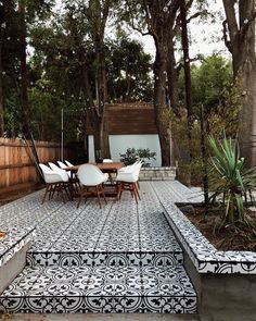 We can't get enough of SIVAN AYLA's black + white tiled patio 😍 Our porcelain Artea Tiles have the best moisture-absorption rating, so they're safe to use outdoors without worrying about damage from water (or wine or apple juice…) Tap to shop! Back Patio, Small Patio, Backyard Patio, Backyard Landscaping, Landscaping Ideas, Modern Backyard, Porch Tile, Patio Tiles, Outdoor Tiles Patio