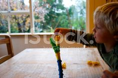 Developing Fine Motor Skills with Toppletree Game royalty-free stock photo Royalty Free Images, Royalty Free Stock Photos, Game Calls, Child Love, Fine Motor Skills, Embedded Image Permalink, Image Now, Games To Play, Natural Health