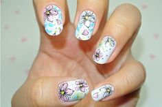 Beautiful illustrated flower nail art
