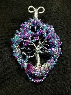 Great! ,Tree of Life inspired by a single bead i saw laying on my creation station! The very small bead was purple with baby blue glass warp around it...  Wasn't expecting this to look this great! I oiseded it on my Twistedbobs Facebook page and someone bought it within 5 mins