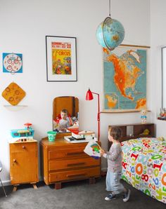 i have a new obession with maps on the wall in a boys room! love the hanging globe too! and that numbers quilt...i think its from Ikea!