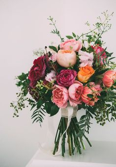 Lastly, this wintery bridal bouquet is filled with cranberry-shaded roses full of romanticism and whimsy.