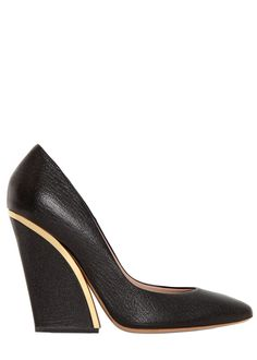 CHLOE- a great approach to the classic black leather shoe. The curve of the heel and the subtle gold accent. Absolutely fabulous and understated.