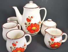 Tea set teapot with cups sugar and milk jug by Dupasseaupresent