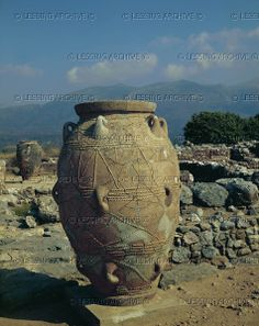 Giant storage vase from the Palace of Mallia, Crete, found near the northern entrance. The surface decorations copy the ropes employed to move these heavy terracotta vessels. Archaeological Site, Mallia,Crete, Greece