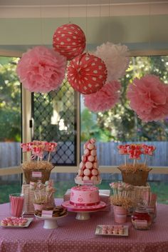 Pink polka dot party ...I love the pompoms! I definately want to use them . we can prob make them pretty easy from tissue paper @jandanappier