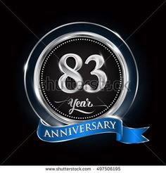 Celebrating 83 years anniversary logo. with silver ring and blue ribbon.
