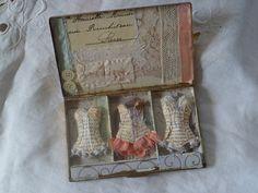 LOVE this little vintage paper corset idea - link to Sue's original post is here: http://www.messiejessieblog.co.uk/vintage-metal-case-assemblage-art-a-surprise-for-mr-darcy/