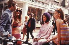 A group of teenagers hanging out on Carnaby Street in their typical 60s attire