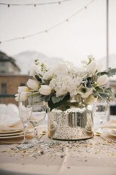 Gray and white neutral centerpiece, mercury glass vase. Would add pops of yellow