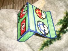 nintendo ds case: plastic canvas, yarn