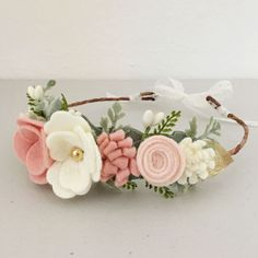 Hand-crafted with love, this felt floral crown would add the perfect whimsical touch to any party, festival, or photo shoot for you or your little one! Crowns are made on either a stretchy nylon headband (one size fits all), or covered wire that is mold-able to any head shape and come in