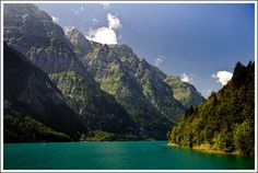 Klöntalersee is a natural lake in the Canton of Glarus, Switzerland