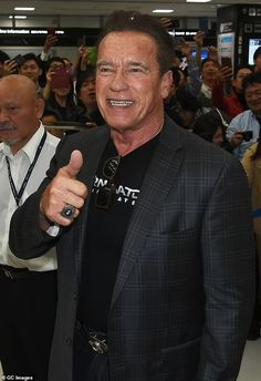 Looking good: The Hollywood icon, looked relaxed as he walked through the terminal whi. Hollywood Icons, Arnold Schwarzenegger, Tokyo, Stars, Film, Movie, Film Stock, Tokyo Japan, Sterne