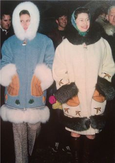 Queen Elizabeth and Princess Anne wearing parkas made in Inuvik, NWT and presented to them on the Royal Visit to the Northwest Territories, Canada in 1970.