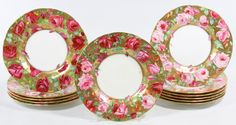 Lot 285: Minton for Spaulding Co. Luncheon Plates; Twelve plates having a gold gilt and rose motif