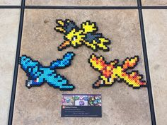 Handmade Perler bead sprites featuring the legendary birds from Pokemon~! They can either be sold together or separately. These make the perfect gift for that nerdy someone and work great as wall decorations, cubicle knick-knacks, or fridge magnets. ITEM DETAILS: - Made with care in a smoke-free home - Ironed on both sides for durability - Pressed to make flat - All measure approximately (height x width): Articuno - (4 x 5.25) Zapdos - (4 x 5.75) Moltres - (3.5 x 5.75) - Feel free to cho...