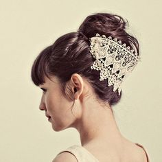 Expect the unexpected with this Venetian lace hairpiece ($50), which would look lovely facing forward as well.