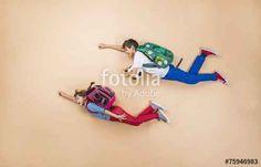"""Téléchargez la photo libre de droits """"Children running to school"""" créée par Halfpoint au meilleur prix sur Fotolia.com. Parcourez notre banque d'images en ligne et trouvez l'image parfaite pour vos projets marketing !"""
