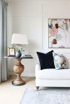 Ladylike florals in living room with wood side table