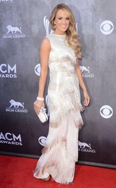 Carrie Underwood makes a retro statement in a silver Oscar de la Renta gown.
