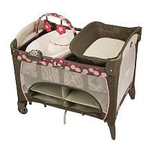 Graco Pack 'n Play Playard with Newborn Napper Station Deluxe - Faith - Graco - The napper was perfect for baby's first couple months; she's now in the bassinet section. The storage underneath has been very handy!