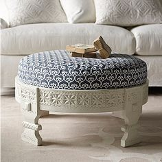 {Custom Upholstered Chakki Ottoman} love the intricate carving of the base!