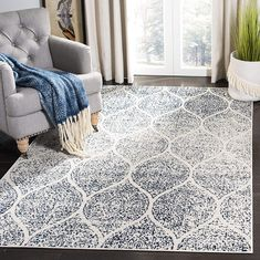 A marvelous exhibit of trendsetting transitional rugs, this collection instills life into extraordinary spaces. Classic designs become fashion-smart home decor in this alluring and colorful collection. Features: Bohemian chic geometric ogee design with a distressed appearance for understated elegance Stylishly versatile, this kid and pet-friendly rug is perfect for the bedroom, living room, playroom, foyer, or dining room Made from enhanced and virtually non-shedding premium polypropylene fibers White Area Rug, Blue Area Rugs, Navy And White Rug, Transitional Home Decor, Transitional Style, Trellis Rug, Geometric Rug, Rugs In Living Room, Living Room Interior