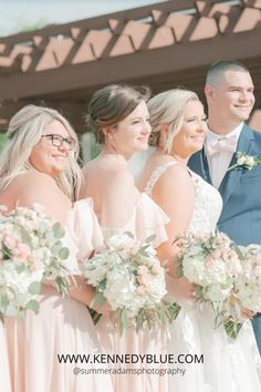 This beautiful wedding party combines navy, pastel pink, and white for the perfect spring wedding palette! The bridesmaids are wearing Kennedy Blue in the beautiful shade of 'Blush' and style 'Allison'. Shop all wedding attire with Kennedy Blue. Summer wedding inspiration | Pastel wedding palette | wedding dress inspiration | #bouquetinspo | #pastelweddings | Kennedy Blue Bridesmaid dresses Spring Wedding Colors, Summer Wedding Colors, Wedding Attire, Wedding Dresses, Blue Bridesmaid Dresses, Wedding Color Schemes, Wedding Inspiration, Bride Dresses, Bridal Gowns