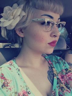 Rockabilly, with a beautiful flower and vintage glasses.