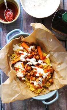 Vegetarian Halal Street Cart Chickpeas with Turmeric Rice, Tahini Yogurt Sauce, and Harissa Oil