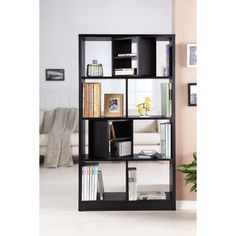 @Overstock - A perfect addition to any room, this Enitial Lab bookcase features a matte black finish and has an open back. This bookcase showcases two cubby blocks with a divided shelf than can swivel 360 degrees.http://www.overstock.com/Home-Garden/Modern-Swivel-Blocks-Bookcase-Display-Stand/6440846/product.html?CID=214117 $225.99