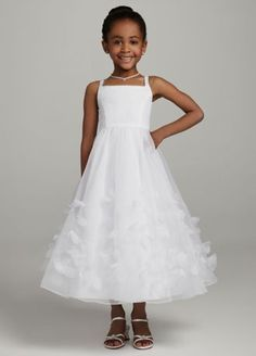 Sugar and spice and everything nice that is what little girls are made of! This saying is definitely true in this gorgeous organza tea length gown!  Sample Sale gowns are only available online (not available in stores).  Sample Sale gowns contain imperfections such as tears in the lining or tulle, or imperfect seams in the skirt, etc.  Specific imperfections are not visible in the photograph shown which is representative of the style and design, not the individual dress that will be shipped.