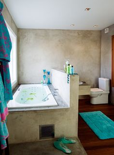 "unusual bathroom layout. Lots of light in bath, when in bath  the ""dirty"" areas (toilet sink) are hidden.  Can see out window / get light when brushing teeth or hair.  Where's a mirror though?"
