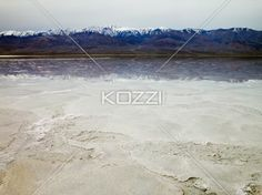 Mountain Top Reflection - The salted land caused by an evaporated salt lake reflects the vivid horizon at Death Valley.