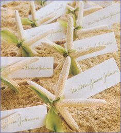 Starfish make a wonderful accent to any event. Shown here as place card holders. Use as table accents with candles, scatter on tables as decorations, tie to gifts as decorative accents.  Name card or ribbon not included. Handmade by Mother Nature