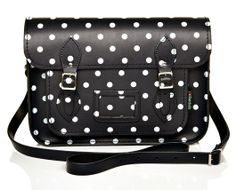 This black satchel with gorgeous white polka dots is complete with top quality hand-stitching and classic metal buckles.