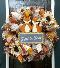 This adorable fox wreath is the perfect way to greet your guests throughout the fall, and is ready to ship now! The cute red fox couple holding