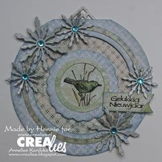 See details:  http://www.crealies.nl/detail/1109567/07-26-hennie.htm and  http://www.crealies.blogspot.nl/2014/07/introductie-crealies-duo-dies-no-2.html  Made by Hennie Barendregt-van Zelst  Made with:   Crealies Duo Dies Sneeuwvlok no. 2  Crea-Nest-Lies XXL no. 4  Crea-Nest-Lies XXL no. 7  Double Fun no. 1  Double Fun no. 13  Nederlandse tekststempel