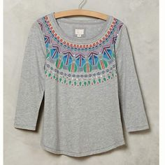 NWT Anthropologie Postcard Tee Size M NEW WITH TAGS -- this delightfully colored t-shirt would look adorable under a casual blazer. Perfect transition piece to move us into the fast approaching spring! Size M Anthropologie Tops Tees - Long Sleeve