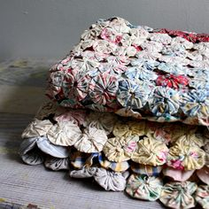 Beautiful yo-yo quilts~❥ my grandmother made these.