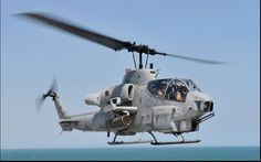 The Bell AH-1 SuperCobra is a twin-engine attack helicopter based on the United States Army's AH-1 Cobra. The twin Cobra family includes the AH-1J SeaCobra, the AH-1T Improved SeaCobra, and the AH-1W SuperCobra. The AH-1W is the backbone of the United States Marine Corps's attack helicopter fleet, but it will be replaced in service by the Bell AH-1Z Viper upgrade.