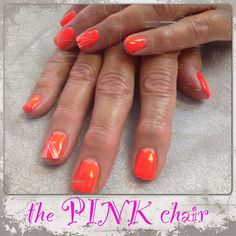 These orange neon gel nails really pop!