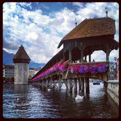 One of Europe's oldest wooden bridges and landmark of Lucerne, faithfully restored to its original design after a serious fire