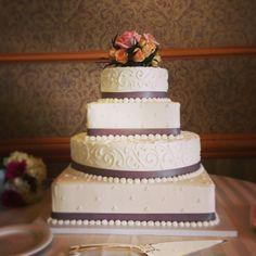 Ivory Square & Round Wedding Cake with Dots, Elegant Scrolls, & Grey Ribbon.