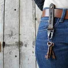 Key Latch Key Latch, made from WWII gunsling leather and metal hook, has been hand-stitched and finished with a brass button stud for connecting to your belt, belt loop or bag.  Keys can be removed conveniently from the latch or the brass stud can be undone so you can open doors, start cars, unlock bike locks et cetera. But never fear! - the metal hook is sturdy and spring loaded. Built to endure, the Key Latch will keep your keys safe and secure.  #pegandawl