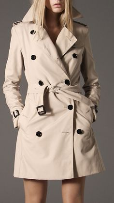 Burberry - MID-LENGTH COTTON BLEND HERITAGE TRENCH COAT.  A good rain coat can be a life saver and all season.  I live in very temperate climate, so I don't need coats -- but when I travel, I layer a cashmere sweater under this burberry -- and can tackle the NE chill.