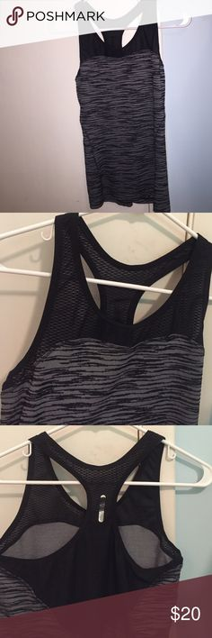 Black and gray workout top with mesh on top SUCH a cute workout top. It's a size medium and barely worn. It's mesh on the top area and the last 2 pictures show the back of it. The brand is Pearl Tzumi Tops Tank Tops