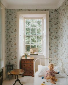 Baby Iris's room in the home of Stella Tennant and David Lasnet, Vogue Living: Houses, Gardens and People. Perfect, sweet, timeless child bedroom. Lovely wallpaper, antiques.